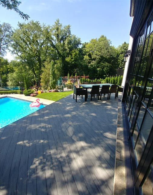 stone-deck-pool-grey-colour-inspiration-ideas-terrace-pool-summer-moisture-resistant-composite-boards-wood-planks-ontario-canada-mississauga-toronto-etobicoke