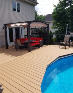 Deck around a pool composite-deck-around-a-pool-with-pergola-and-outdoor-furniture---multi-level-deck-in-colour-sand-beige-design-line---available-in-Mississauga-brampton-caledon-ontario-canada